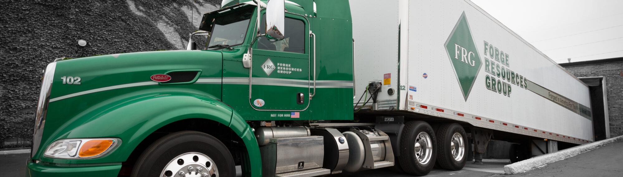 green semi-truck, black and white surroundings