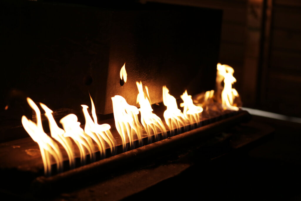 flames warming up workpiece for manufacturing