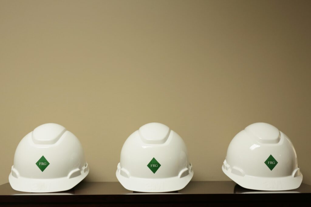 white safety hard hats on shelf